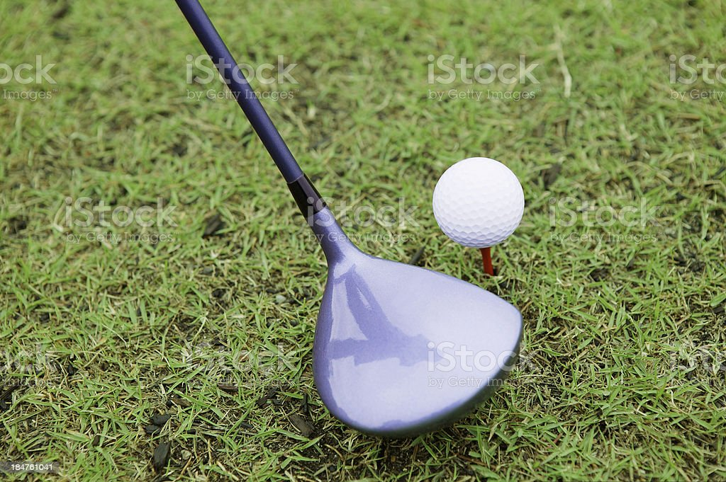 Ready to drive a golf ball royalty-free stock photo