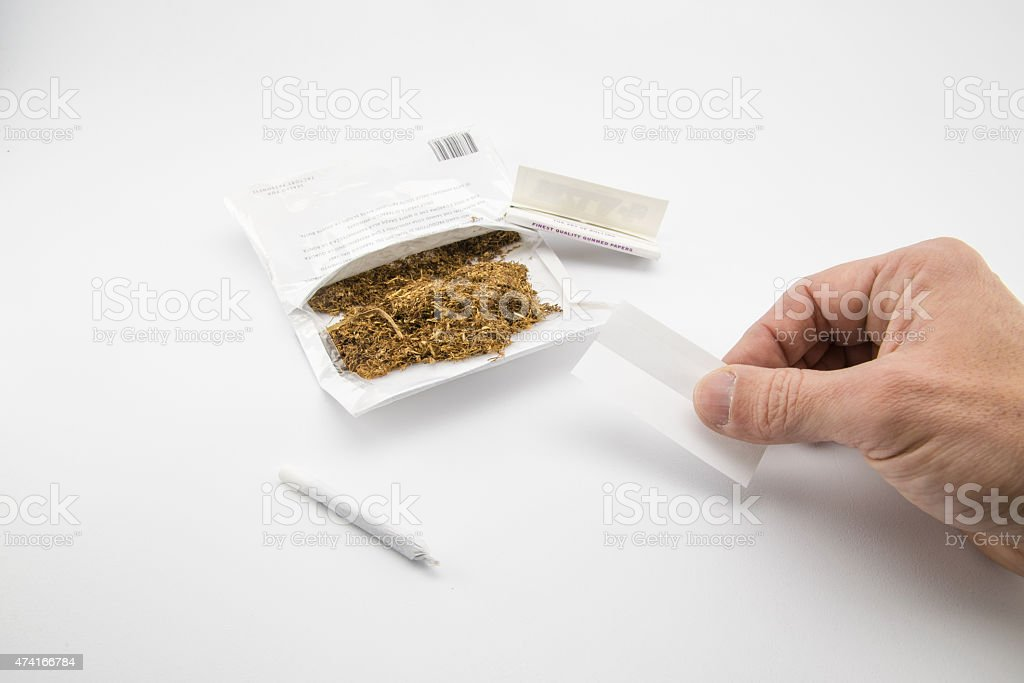 ready to make another cigarette stock photo