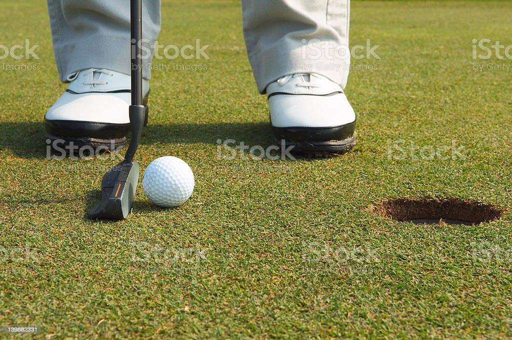 ready to putt - golf ball near hole royalty-free stock photo
