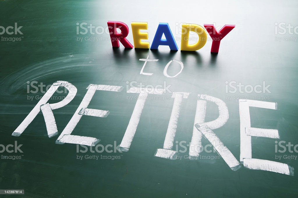 Ready to retire, conceptual words on blackboard. stock photo