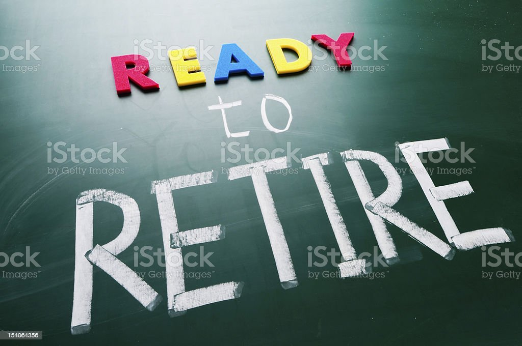 Ready to retire written on a blackboard in chalk and magnets royalty-free stock photo