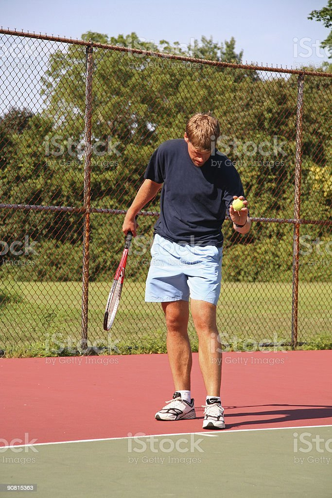 Ready to serve the tennis ball royalty-free stock photo