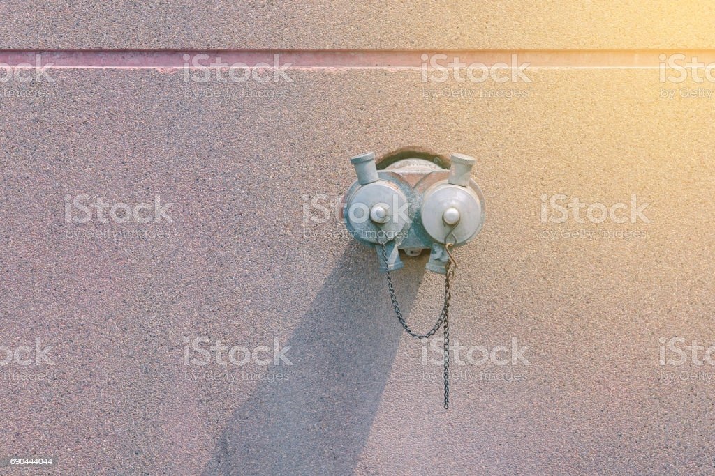 Ready to use fire hydrant on the wall. stock photo