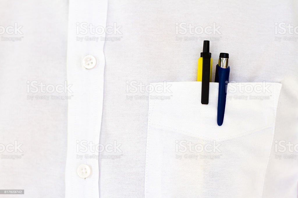 Ready to Write: Two Pens in White Shirt Pocket stock photo
