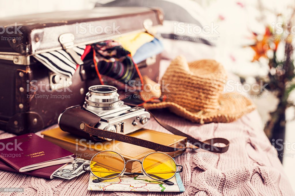 Ready vacation suitcase on bed stock photo