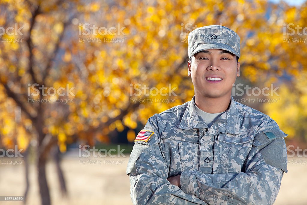 Real American Soldier Outdoor Against Autumn Background stock photo