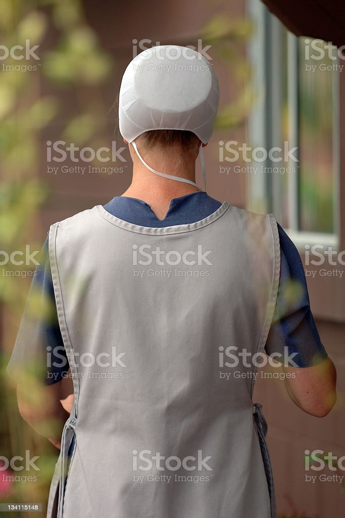 Real amish woman from behind stock photo