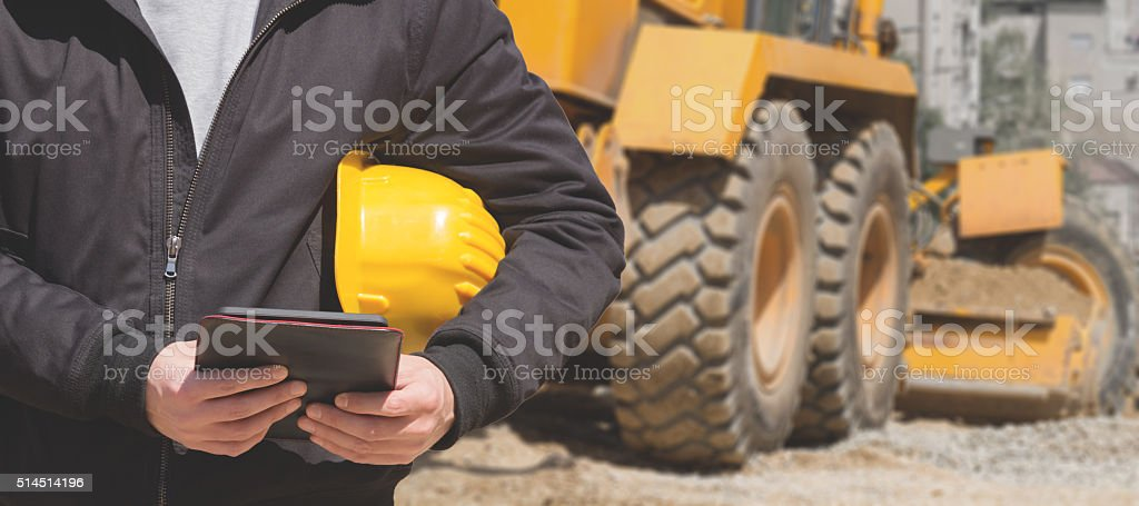 Real and ordinary construction worker on his job. stock photo