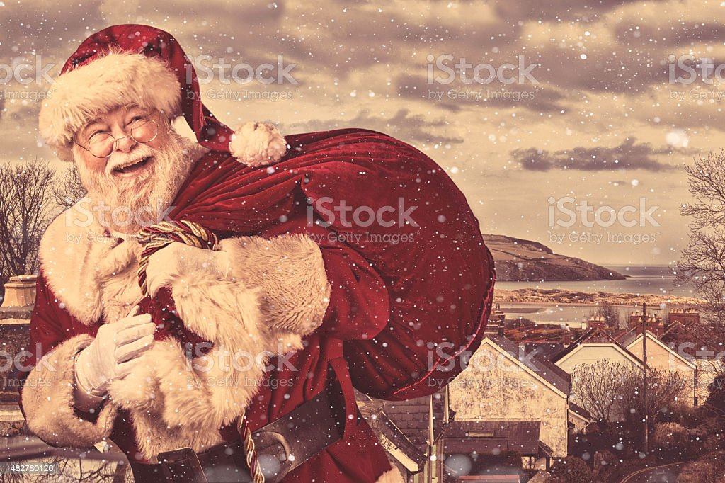 Real authentic Christmas photo of Santa Claus coming to town stock photo
