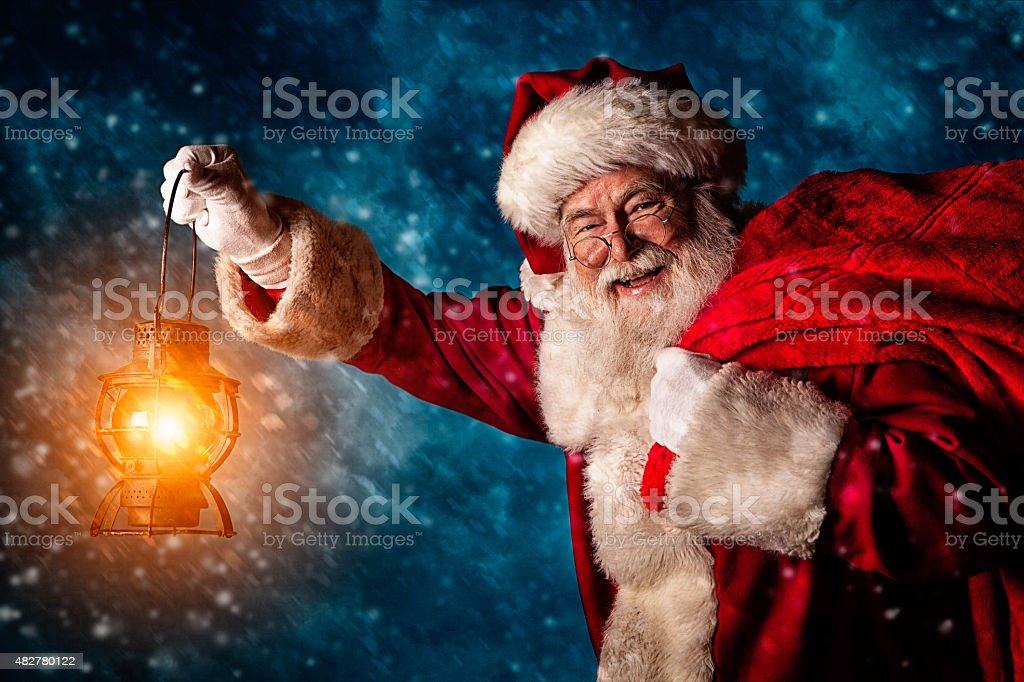 Real authentic Christmas photo of Santa Claus in the snow stock photo