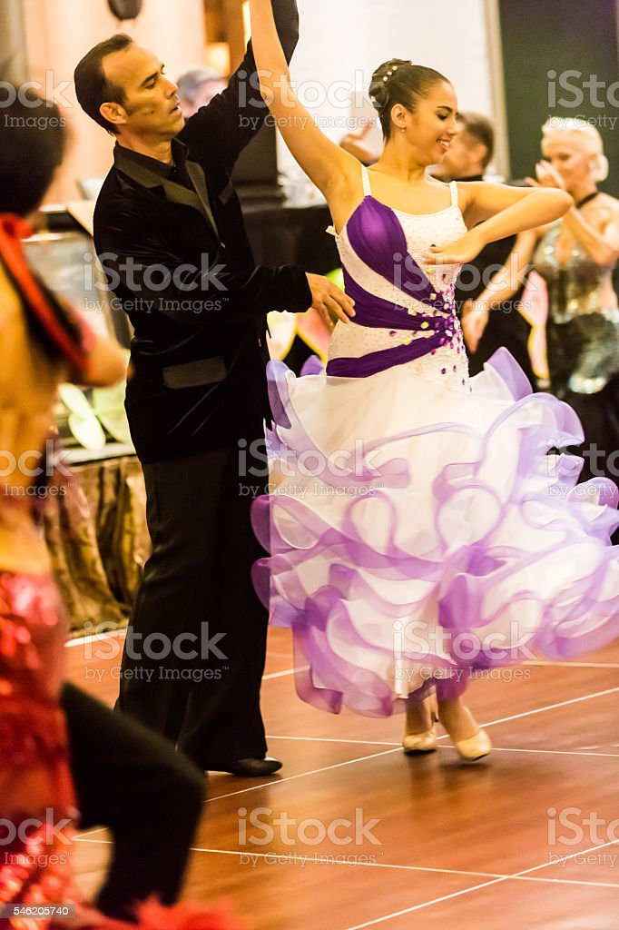Real ballroom dancers at dance competition stock photo