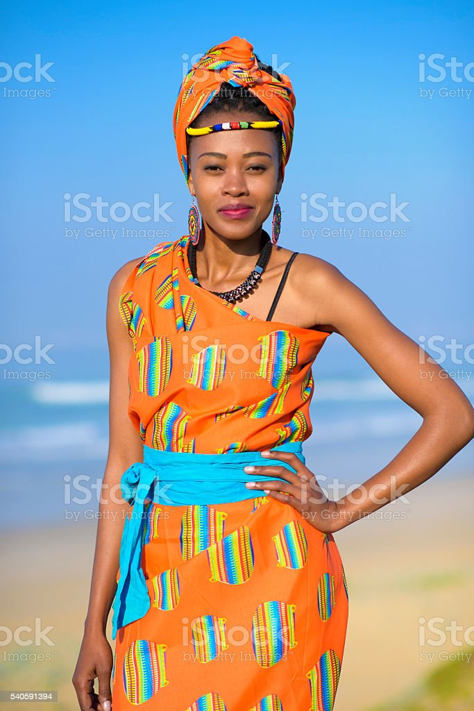 Outdoor shoot of an young african woman on the beach