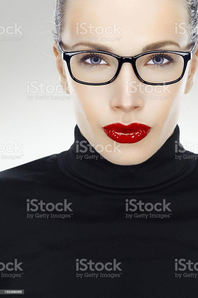 Close-up, beauty headshot of a beautiful smiling woman wearing...