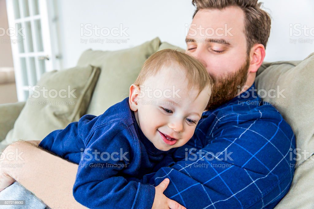 Real caucasian father with his smiling one year old son stock photo