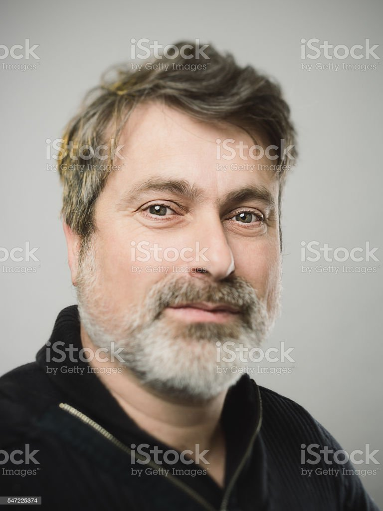 Real caucasian mature adult man portrait with happy expression stock photo