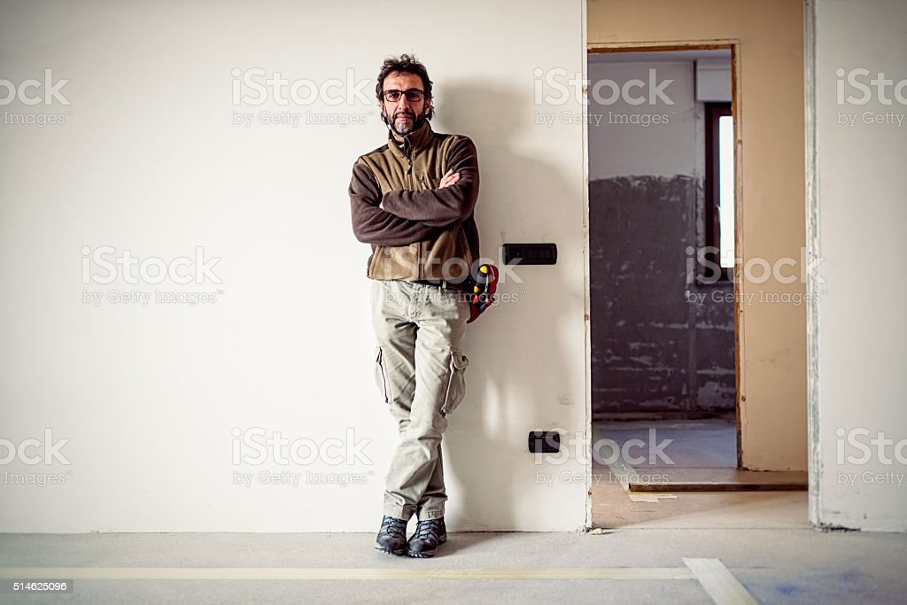 Real electrician in repairing apartment stock photo
