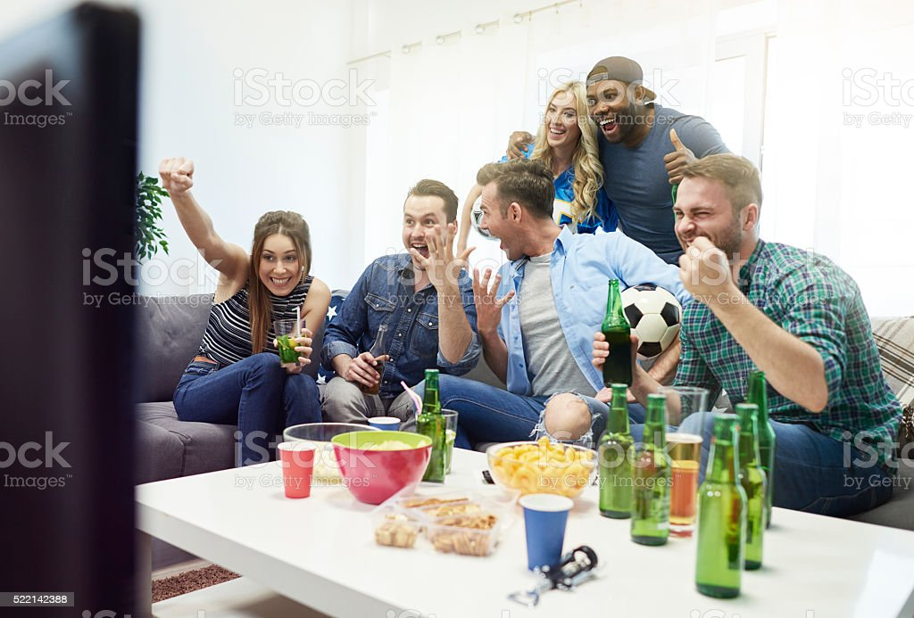 Real emotions while watching soccer match stock photo