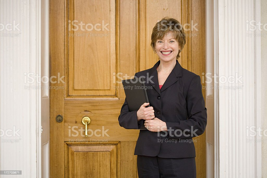 real estate agent at front door royalty-free stock photo