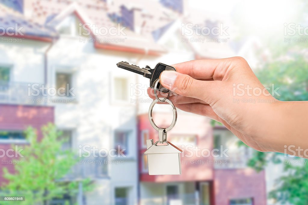 Real estate agent giving house key. stock photo