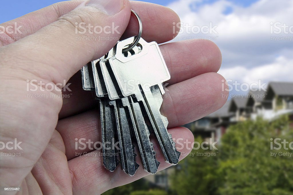 Real Estate agent hands over the keys. royalty-free stock photo