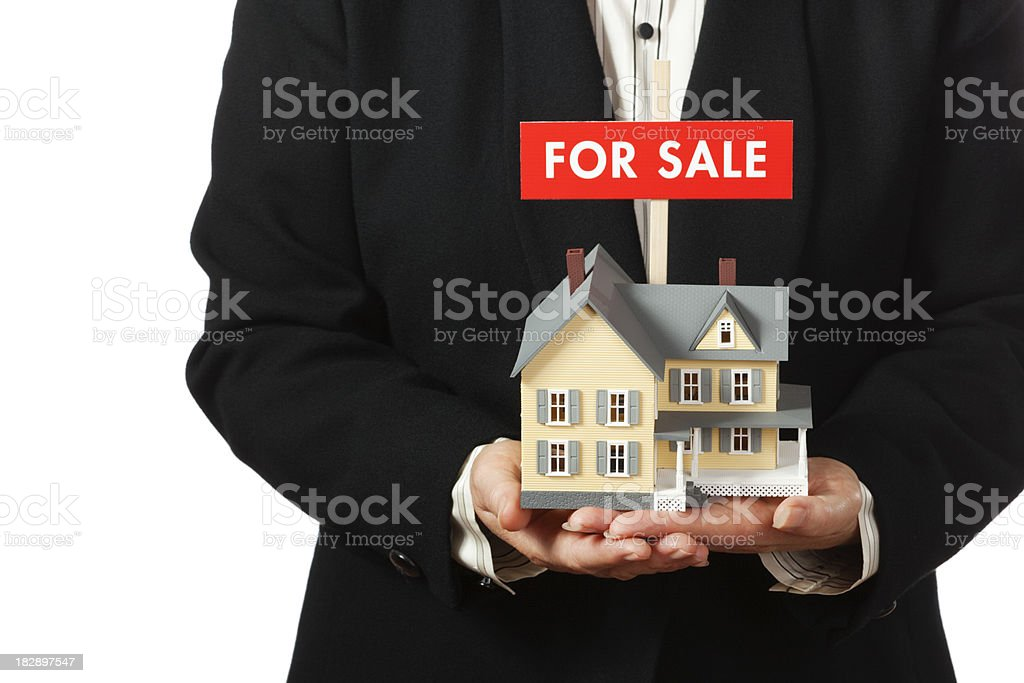Real Estate Agent Offering Residential Home FOR SALE royalty-free stock photo