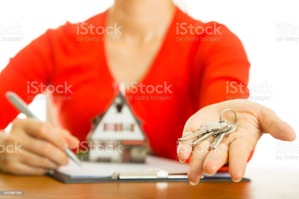 Real estate agent passing key concept with white background stock photo