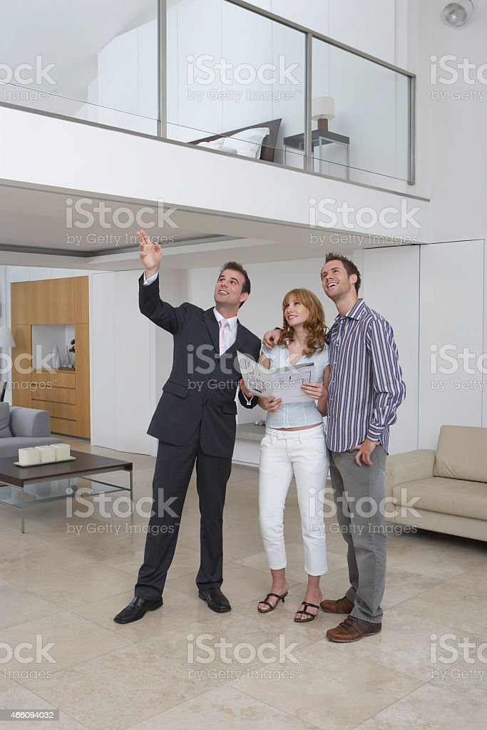 Real Estate Agent Showing Couple New Home stock photo