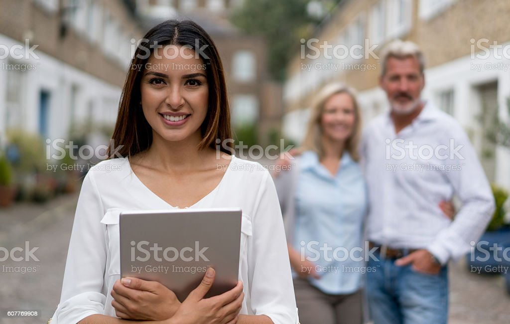 Real estate agent showing houses stock photo