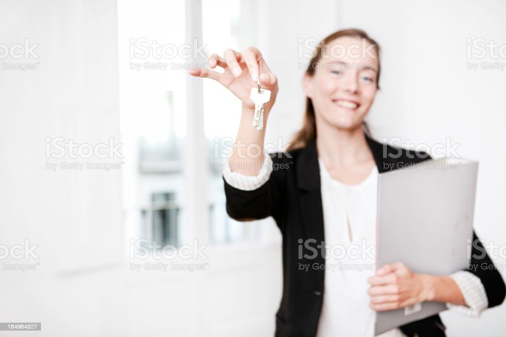Real estate agent showing keys royalty-free stock photo