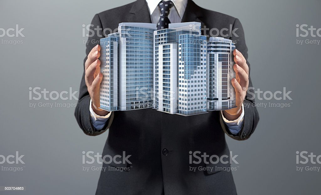 Real estate agent showing modern office buildings for sale stock photo