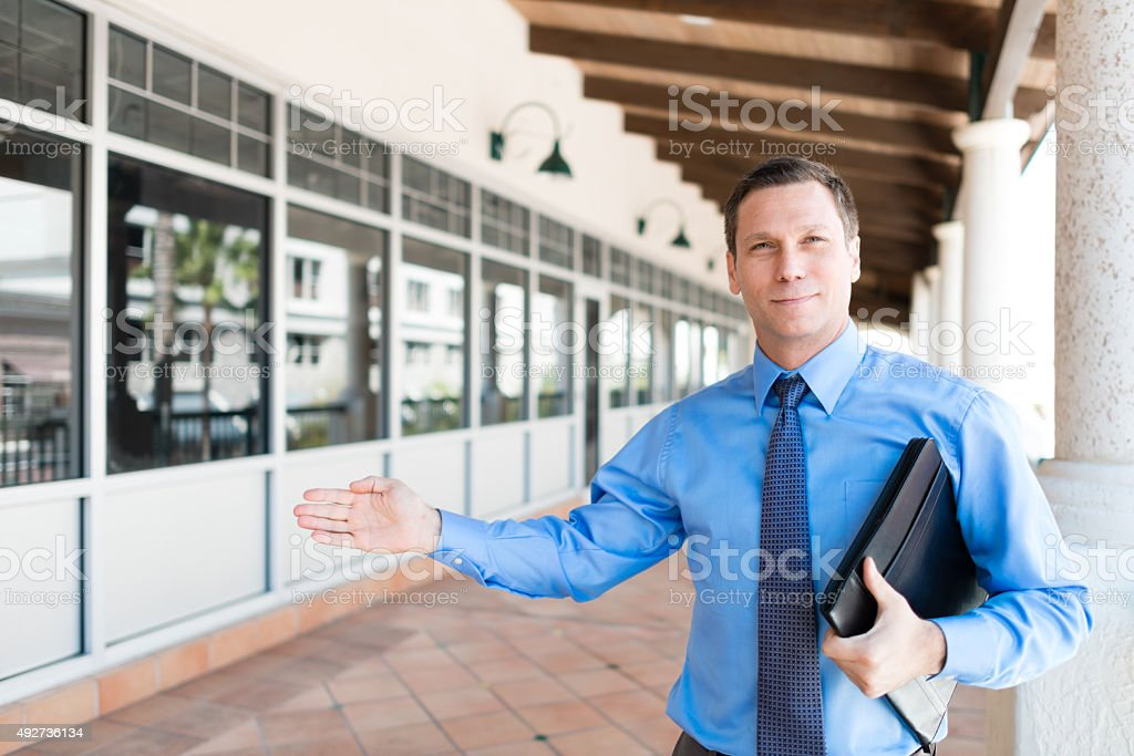 Real Estate Agent Showing Property stock photo