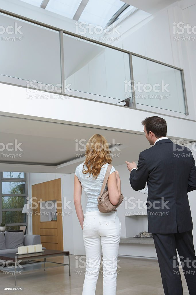 Real Estate Agent Showing Woman New House stock photo