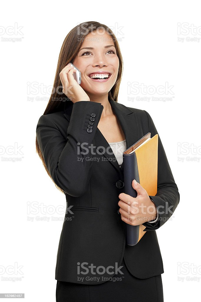 Real estate agent talking on mobile phone stock photo