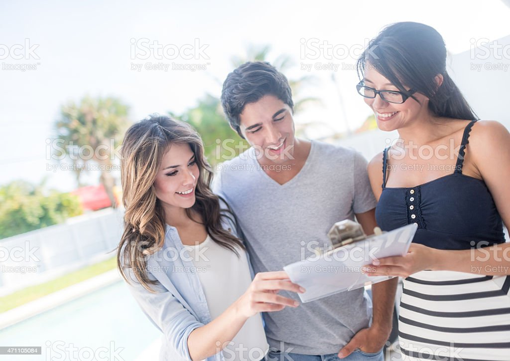 Real estate agent talking to a couple stock photo