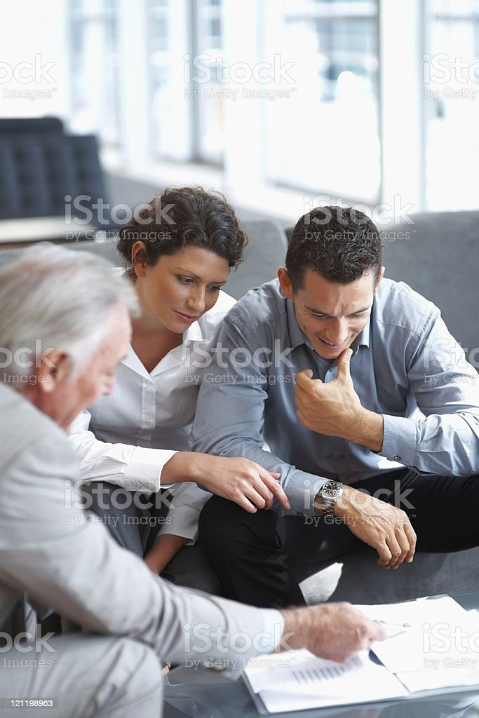 Real estate agent talking to a mature couple royalty-free stock photo