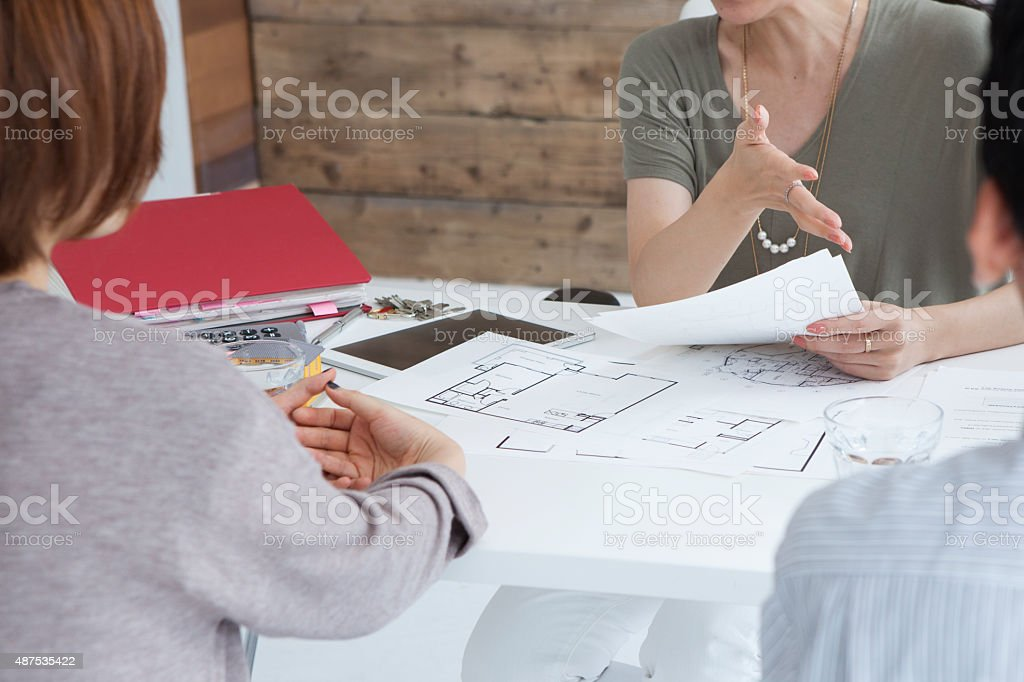 Real estate agent to be eager to explain to customers stock photo