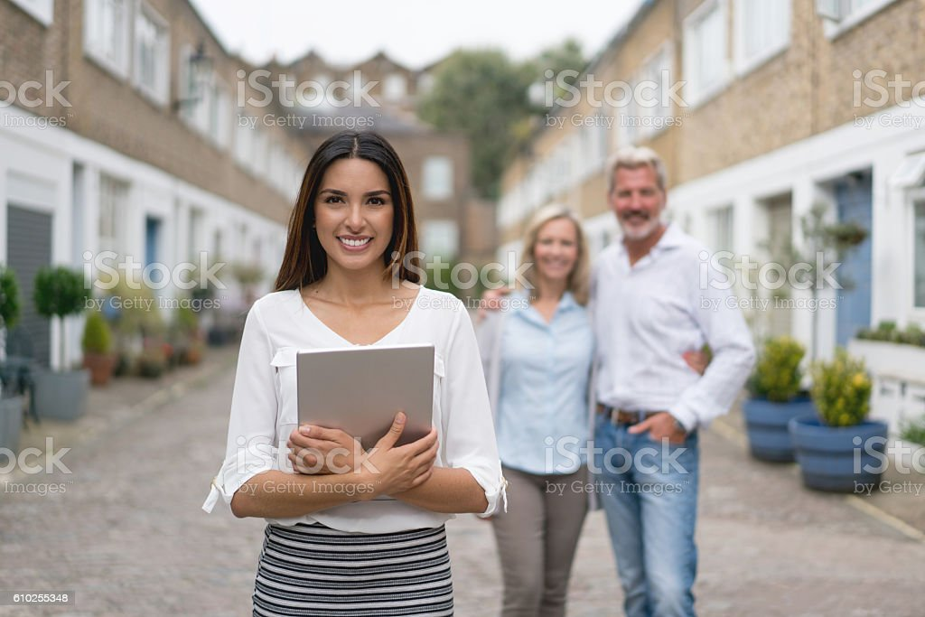 Real estate agent with clients stock photo