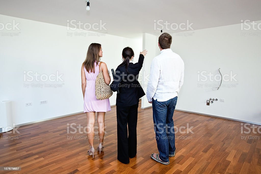 Real estate agent with customers royalty-free stock photo
