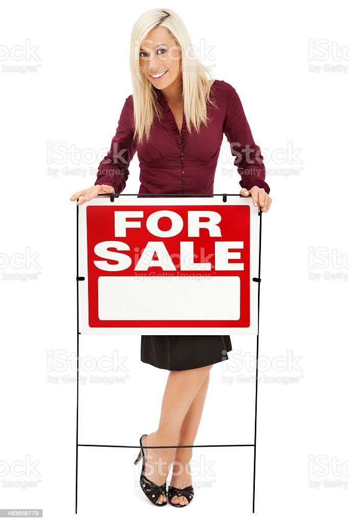 Real Estate Agent with For Sale Sign royalty-free stock photo