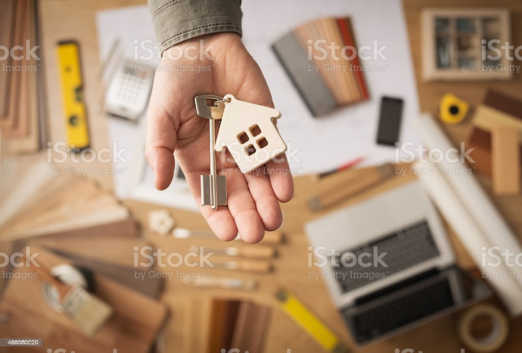 Real estate agent with house key stock photo