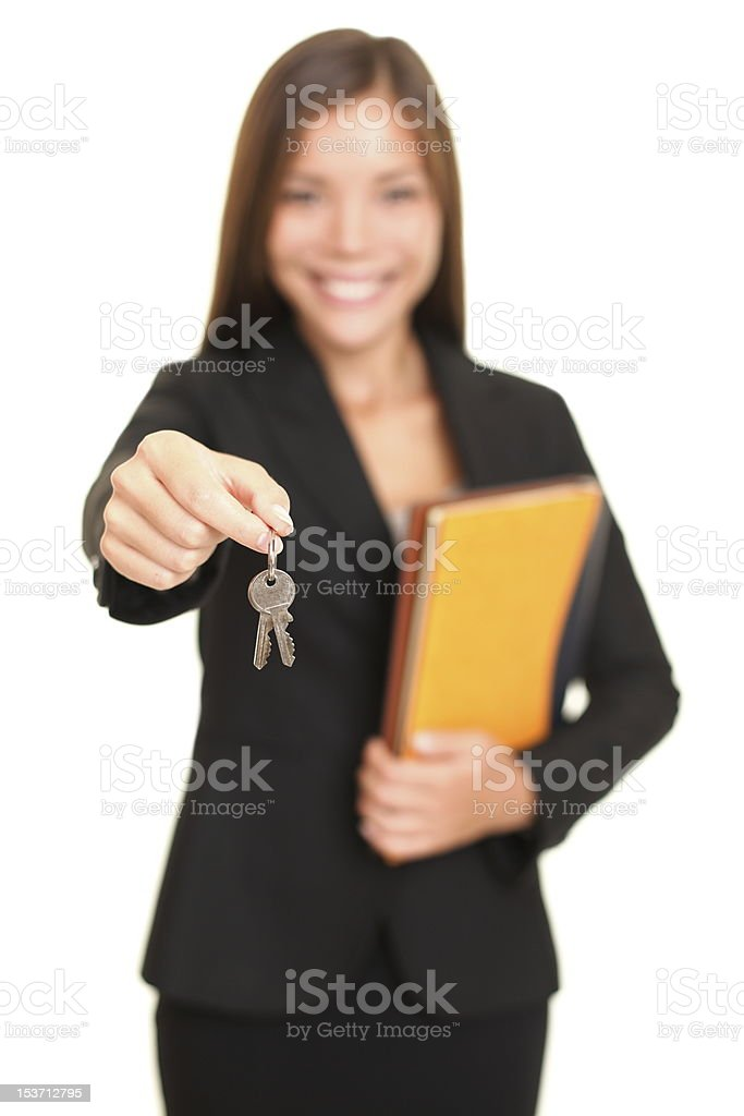 Real estate agent woman giving keys royalty-free stock photo
