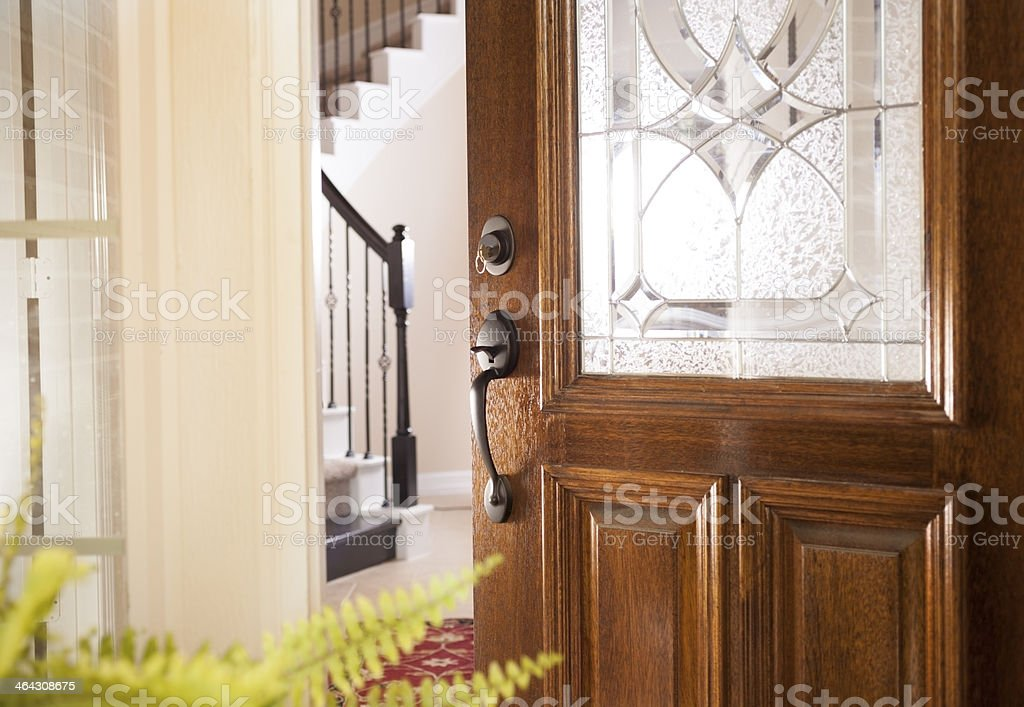 Real Estate, Architecture: Open door to modern home. House key. stock photo