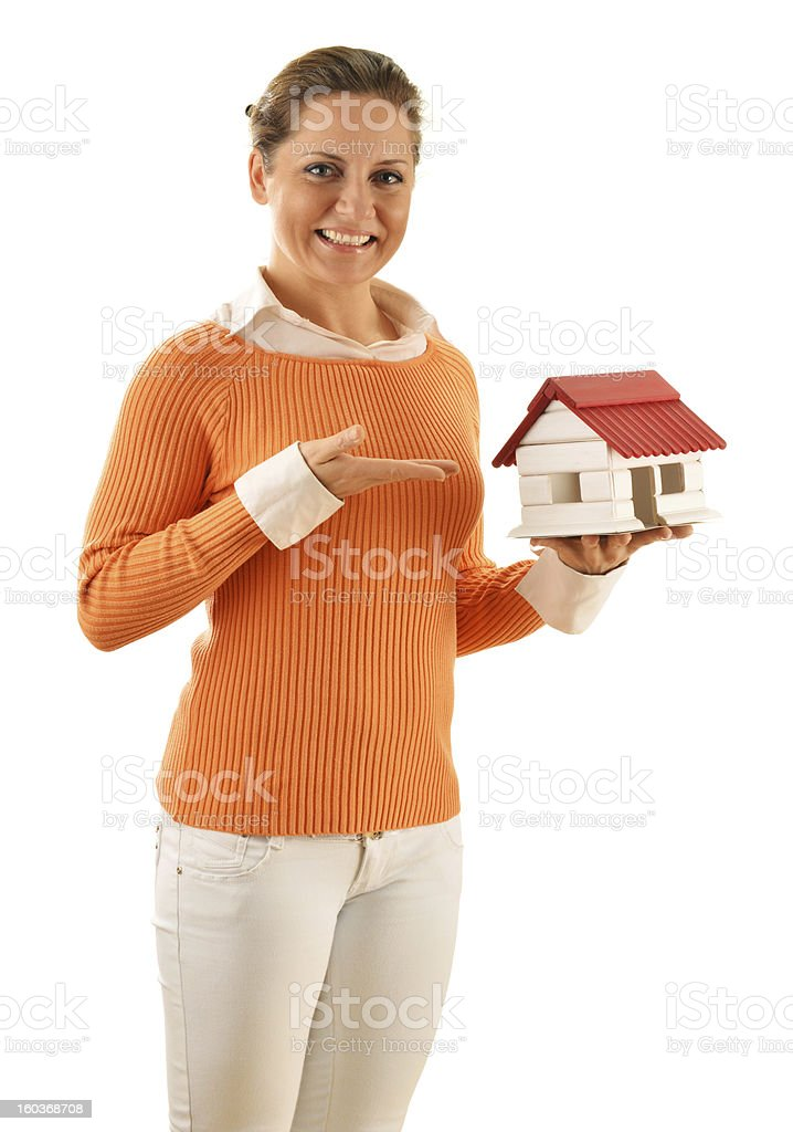 Real estate broker holding small house isolated on white royalty-free stock photo