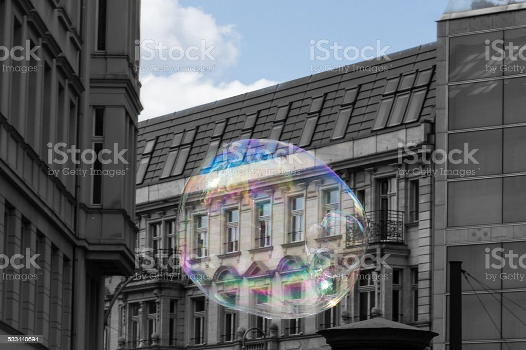 real estate bubble, concept - soap bubble - building facade stock photo