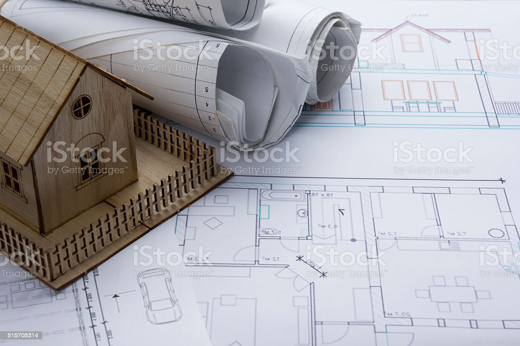 Real Estate concept. Architect workplace. Architectural project, blueprints, blueprint rolls stock photo