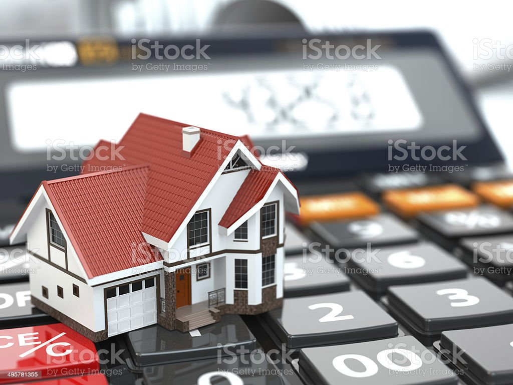 Real estate concept. House on calculator. Mortgage. stock photo
