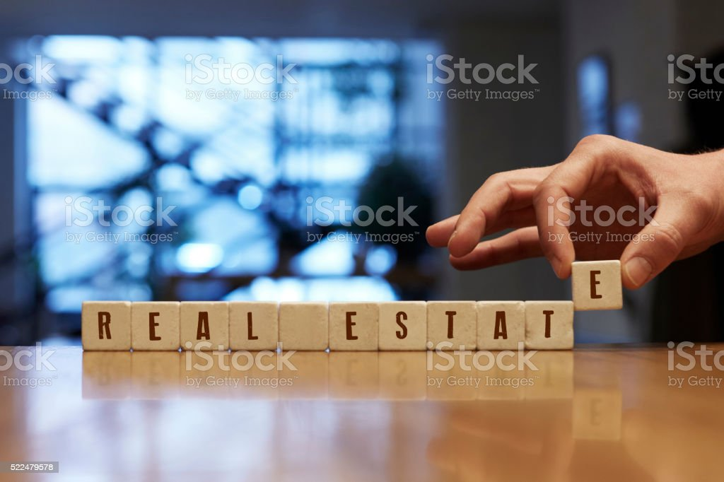 Real Estate Concept with Alphabet Blocks stock photo