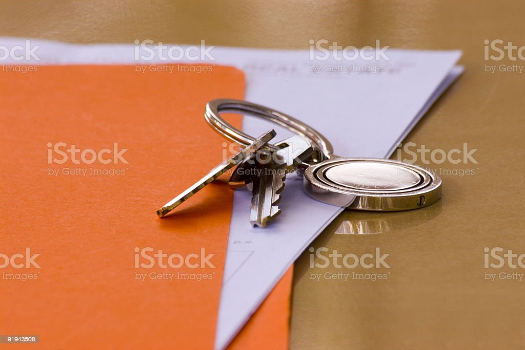 Real Estate Contract and Keys with Orange Folder stock photo