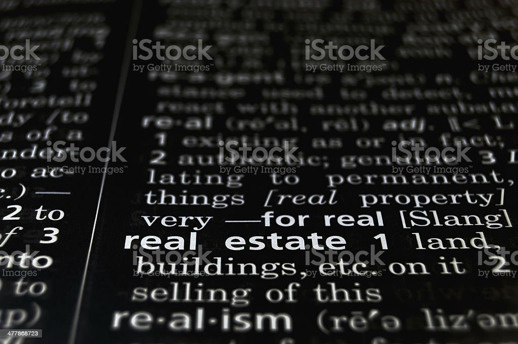 Real Estate Defined on Black royalty-free stock photo