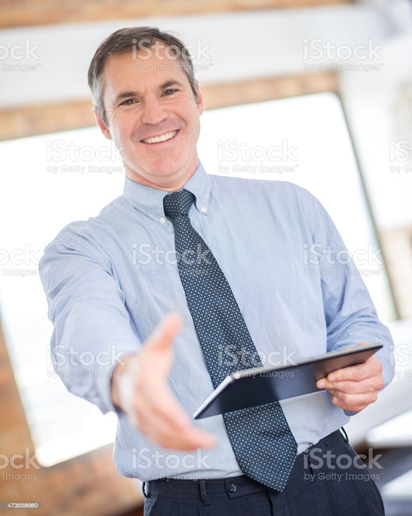 Real estate developer ready to handshake stock photo